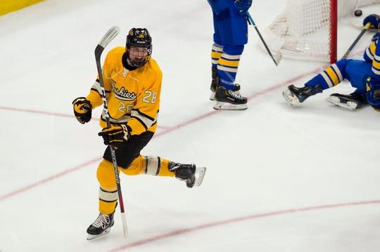 Trenton Bliss, a freshman forward at Michigan Tech, celebrates a goal against Lake Superior State earlier this season.