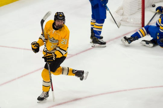 Trenton Bliss, a freshman forward at Michigan Tech, celebrates a goal against Lake Superior State earlier this season.