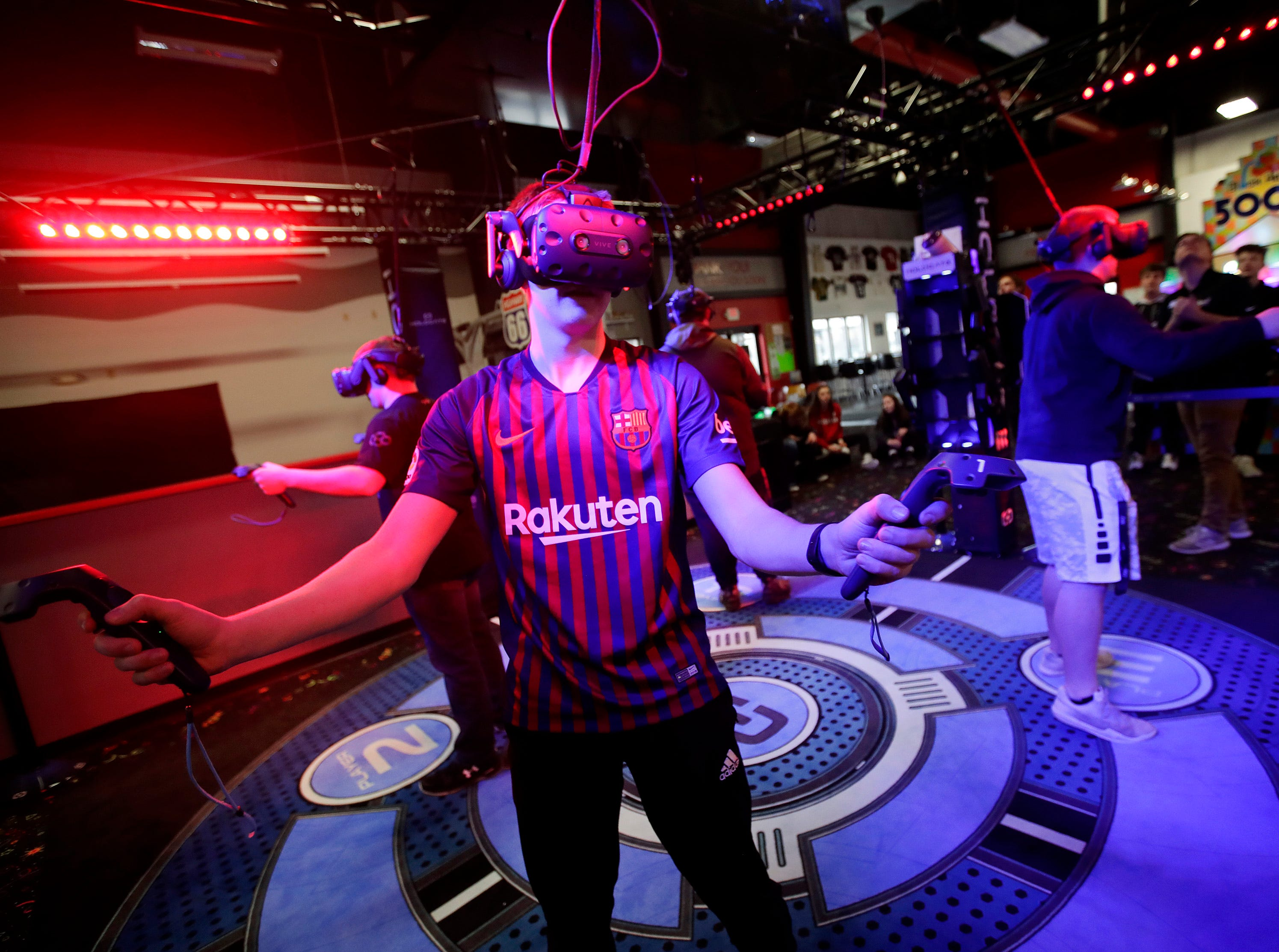 Eli Ruplinger, a senior at Kimberly High School uses the new Hologate virtual reality gaming system at Badger Sports Park during a Lifetime Sports and Fitness physical education class with Kimberly High School Tuesday, Jan. 8, 2019, Appleton, Wis. Badger Sports Park started using the VR system in December.