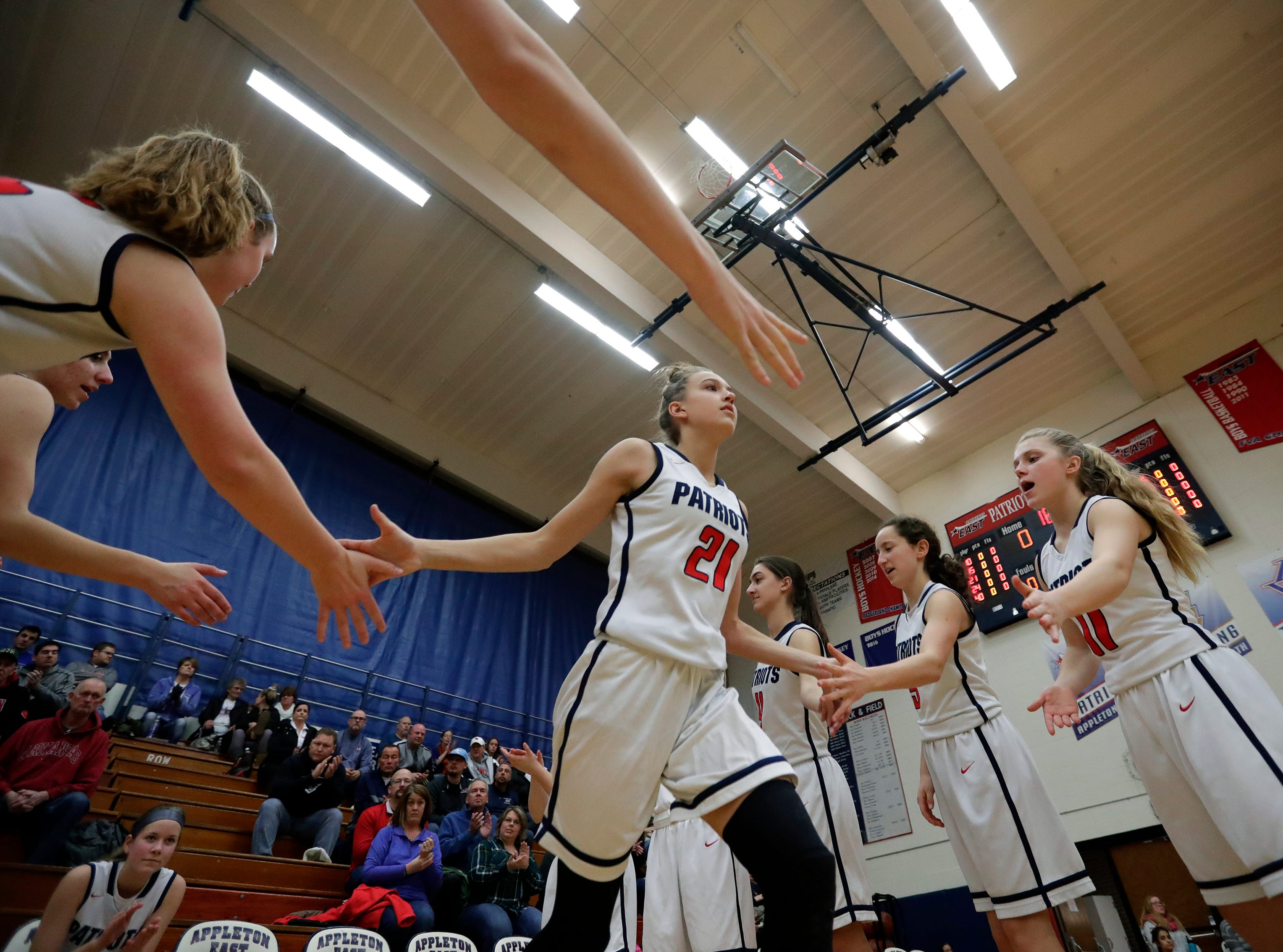 Appleton East High School's Emily LaChapell (21) takes to the court as she is announced against Appleton West High School during their girls basketball game Friday, January 11, 2019, at Appleton East High School in Appleton, Wis. 