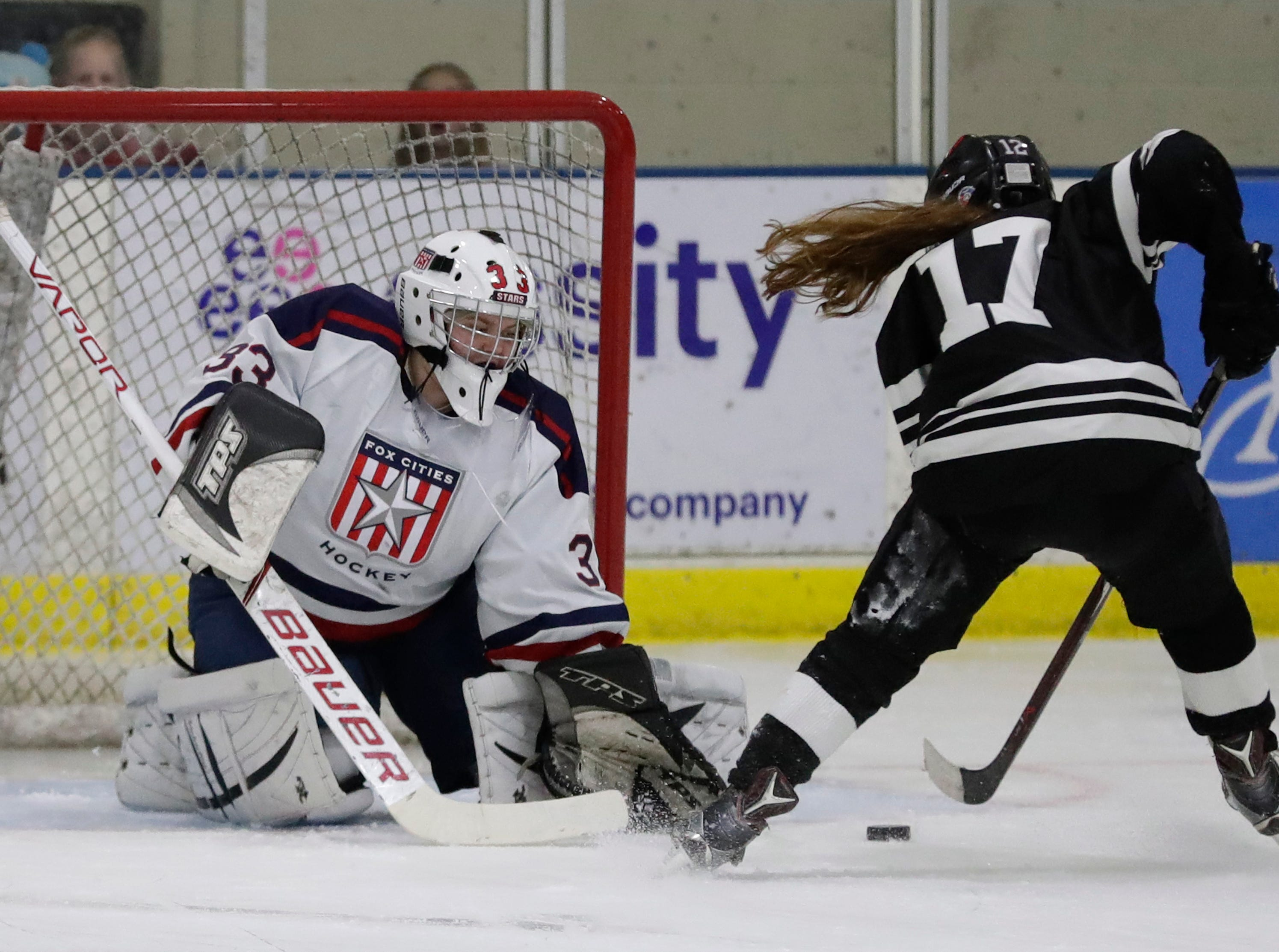The Warbirds' Hattie Verstegen (17) scores on a penalty shot against Fox Cities Stars' Hattie Berndt (33) during their girls hockey game Thursday, January 10, 2019, at Tri-County Ice Arena in Fox Crossing, Wis. 