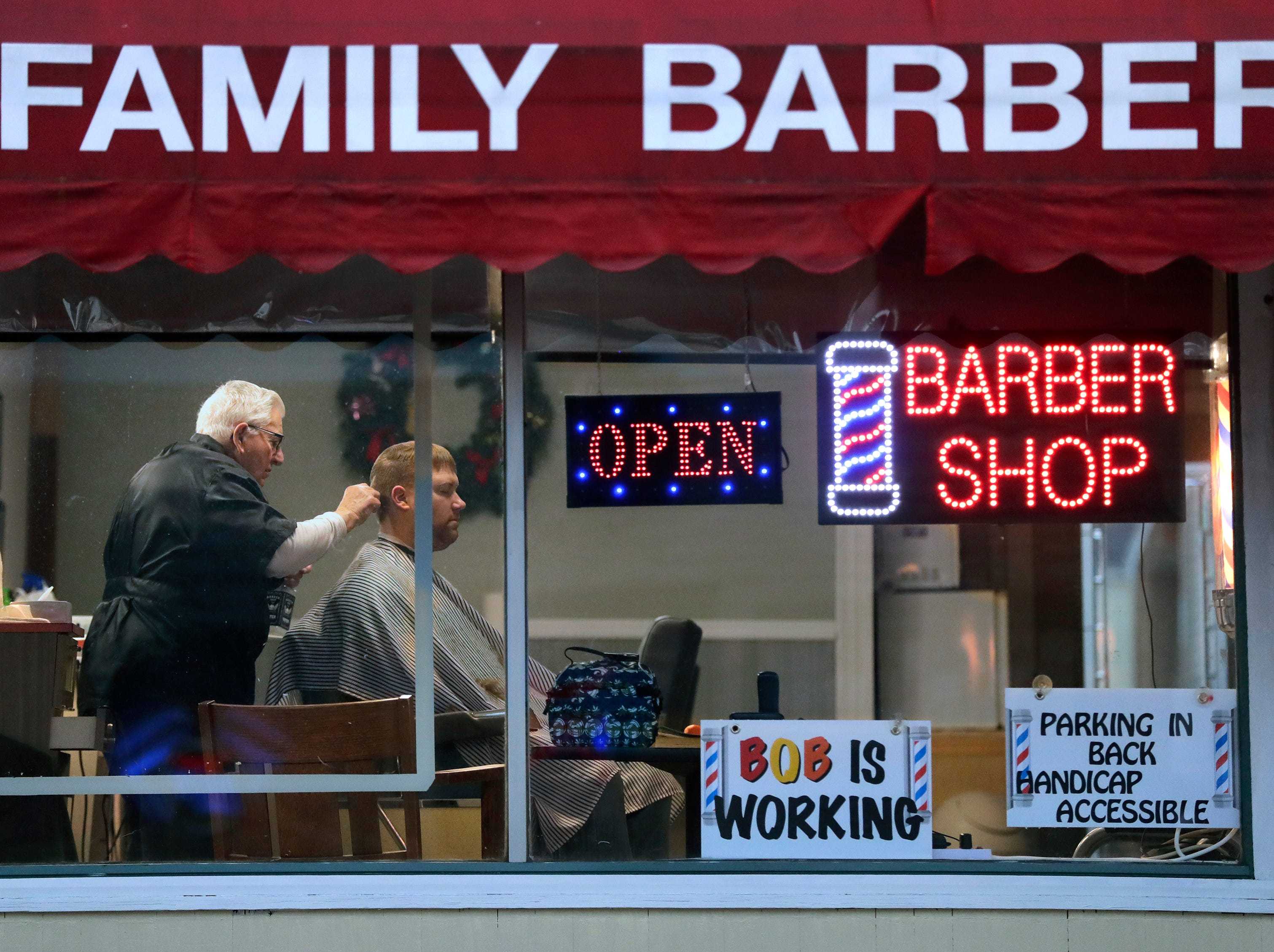 Bob Rohloff, left, of Appleton gives a haircut to Braxton Caswell of Hortonville Monday, January 7, 2019, at MWS Family Barbershop in downtown Hortonville, Wis. Rohloff, 86, says he's been cutting hair since 1948. The building was built the 1890's and has always been a barbershop.