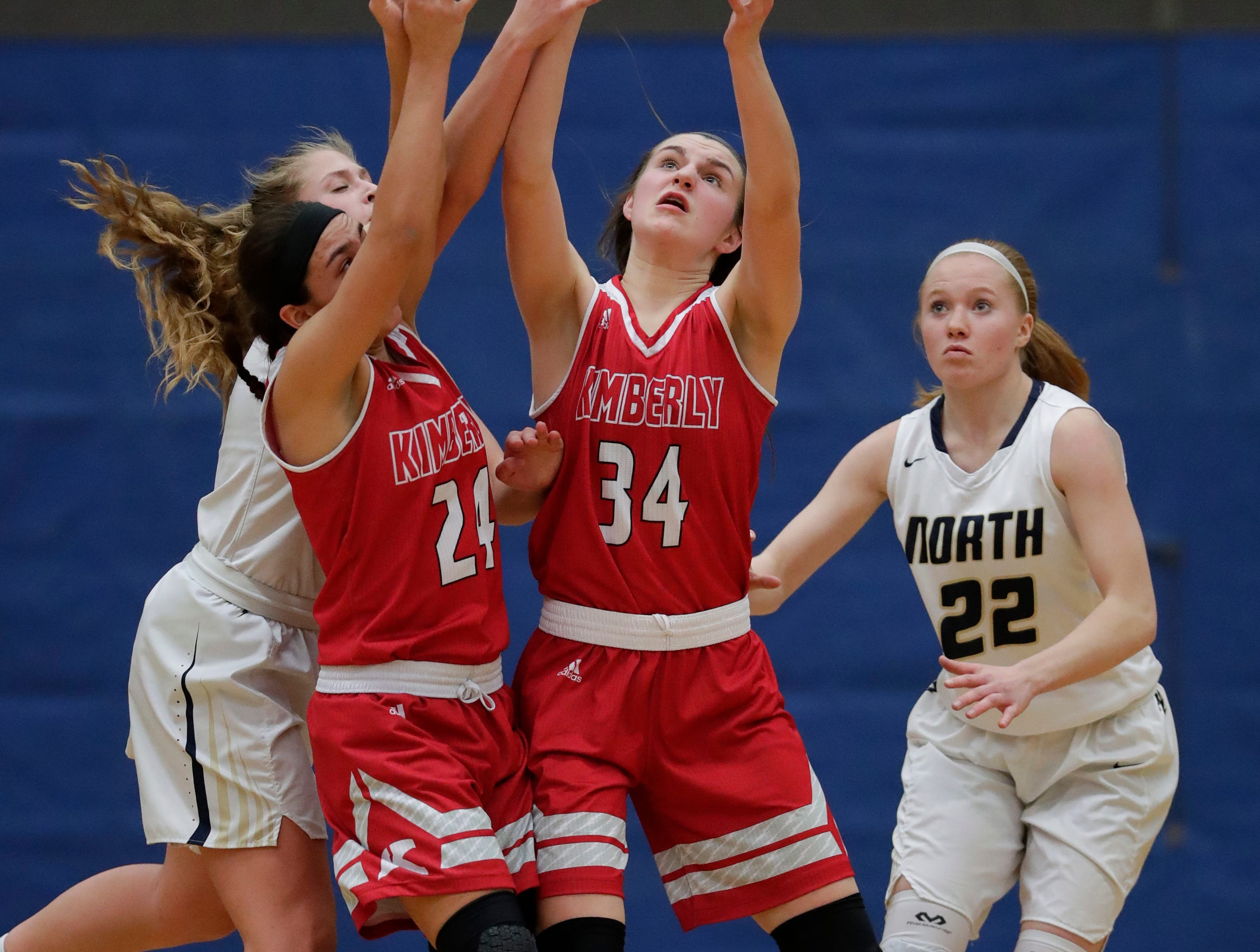 Appleton North High School's Lilli Van Handel (21) and Kayla Schroeder (22) go for a rebound against Kimberly High School's Shea Dechant (24) and Maddy Schreiber (34) during their girls basketball game Tuesday, January 8, 2019, in Appleton, Wis. 