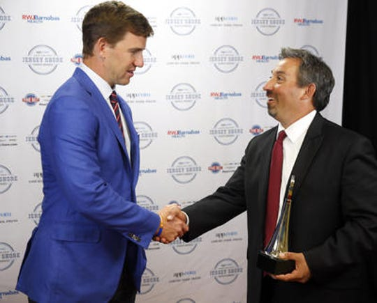 Nick Giglio (right), shown with Giants' quarterback Eli Manning at the Asbury Park Press Sports Awards in June 2016, has resigned as Red Bank Regional's head football coach