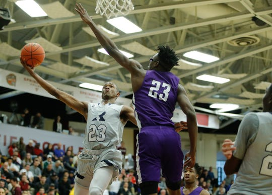 Jan 14, 2018; Springfield, MA, USA; The Ranney School guard Scottiue Lewis (23) shoots against Mount Saint Joseph forward Jalen Smith (23) during game five on Sunday as some of the top high school basketball teams in the country compete at the Hoophall Classic.