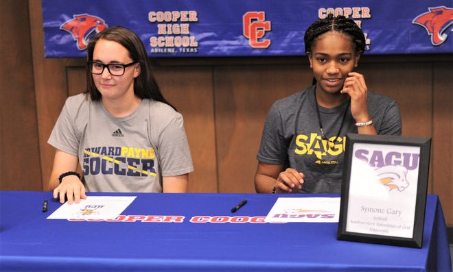 Cooper's Savannah Gregory, left, and Symone Gary were part of a signing ceremony Monday,  Jan. 14, 2019, at Cooper High School. Gregory will play soccer at Howard Payne, while Gary will play softball at Southwestern Assemblies of God.