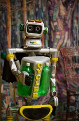 This photo taken Nov. 19, 2018, shows a motorized robot made from recycled materials stands in an education room filled with art made from recycled materials at Waste Management's facility on Gasmer Drive in southwest Houston. ( Mark Mulligan /Houston Chronicle via AP)