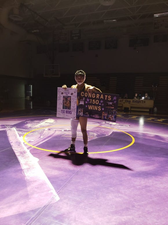 North Henderson's Josh Felize won his 150th career match on Friday