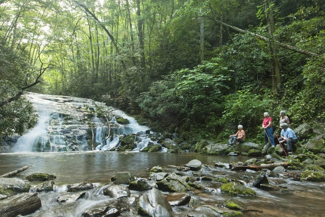 Hikers take in Indian Creek Falls, located not far from Deep Creek in Great Smoky Mountains National Park, in a 2012 photo. Park officials announced that workers will reopen restrooms at Deep Creek Picnic Area nearby.