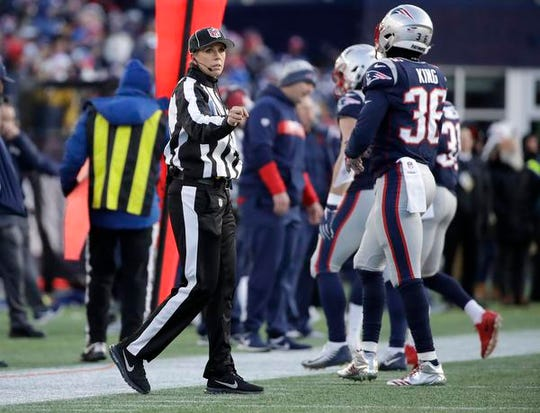 Down judge Sarah Thomas works along the sideline during the second half of an NFL divisional playoff football game between the Los Angeles Chargers and the New England Patriots, Sunday, Jan. 13, 2019, in Foxborough, Mass. Thomas is the first woman to officiate an NFL playoff game. (AP Photo/Elise Amendola)