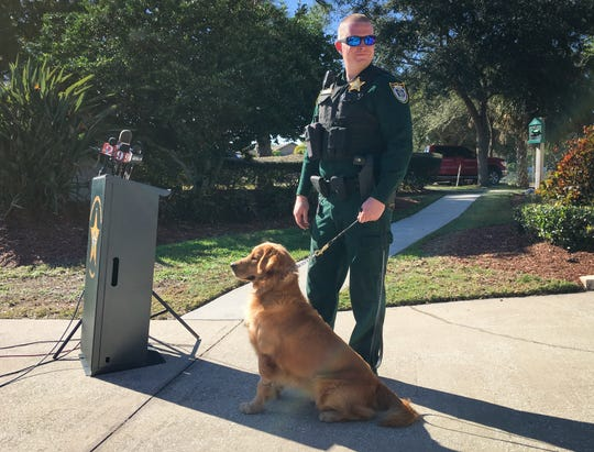 Deputy Scott Stewart and K9 companion Jake after Jake's recovery from amphetamine exposure.