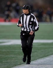 Down judge Sarah Thomas works along the sideline during the second half of an NFL divisional playoff football game between the Los Angeles Chargers and the New England Patriots, Sunday, Jan. 13, 2019, in Foxborough, Mass. Thomas is the first woman to officiate an NFL playoff game. (AP Photo/Charles Krupa)