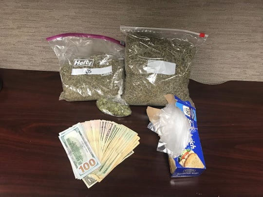 Jim Wells County Sheriff's Office deputies nearly two pounds of synthetic marijuana, marijuana and cash inside a vehicle during a traffic stop on U.S. Highway 281 on Sunday, Jan. 13, 2019.