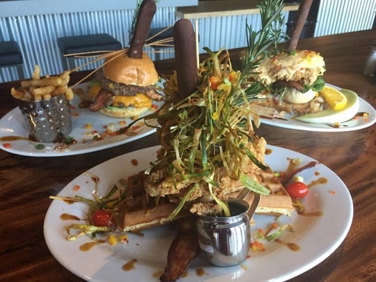 At Hash House a Go Go, Andy's Famous Sage Fried Chicken, served with waffles is the star of the show. At left is one of the restaurant's many stuffed burgers, and at right, a Sage Fried Chicken Benedict.