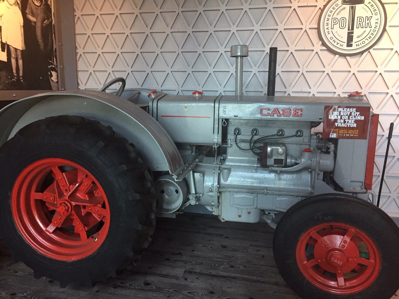 A Case farm tractor sets the tone as guests enter Hash House a Go Go from the parking lot at Moorestown Mall. The restaurant is in the site formerly occupied by Distrito.