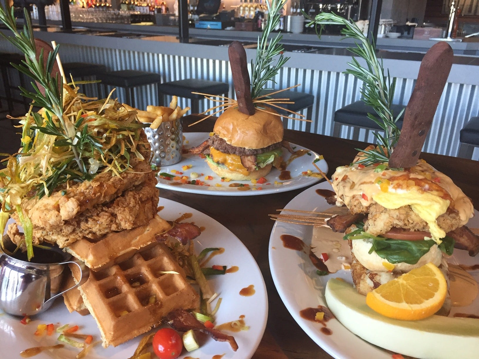 Clockwise from left, Hash House a Go Go's Crisp Sage Chicken and Waffles, a stuffed cheeseburger and Crisp Sage Chicken Benedict. The restaurant at Moorestown Mall offers brunch til 4 p.m. daily.