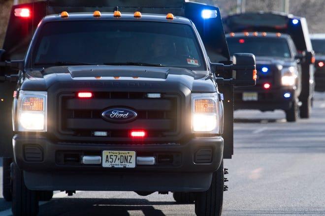 Officials respond to an active shooter at a UPS facility Monday, Jan. 14, 2019 in Logan Township, N.J.
