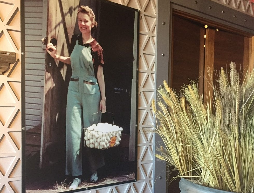 A homey portrait of a farm worker carrying eggs greets guests entering the dining room of Hash House a Go Go in Moorestown Mall.