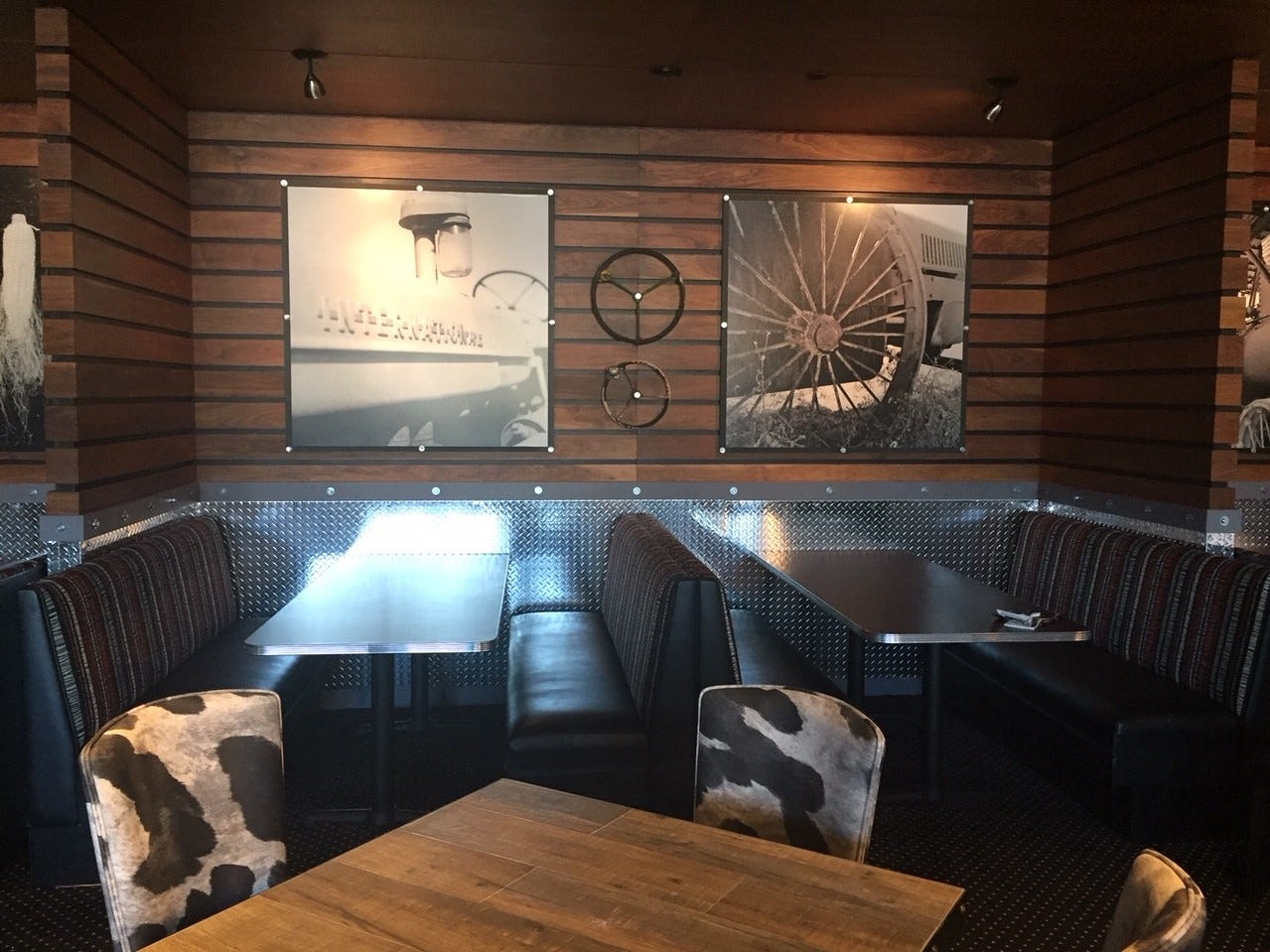 Cow-patterned chairs liven up the dining room of Hash House a Go Go in Moorestown Mall.