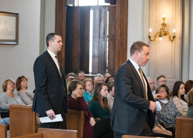 As dozens of supporters watch, Jeff Fisher walks inside Judge Mike Ater's Ross County Courtroom behind his lawyer Brad Koffel to hear what sentence Judge Ater will hand down to the former Chillicothe High School principal on Jan. 14, 2019, in Chillicothe, Ohio.