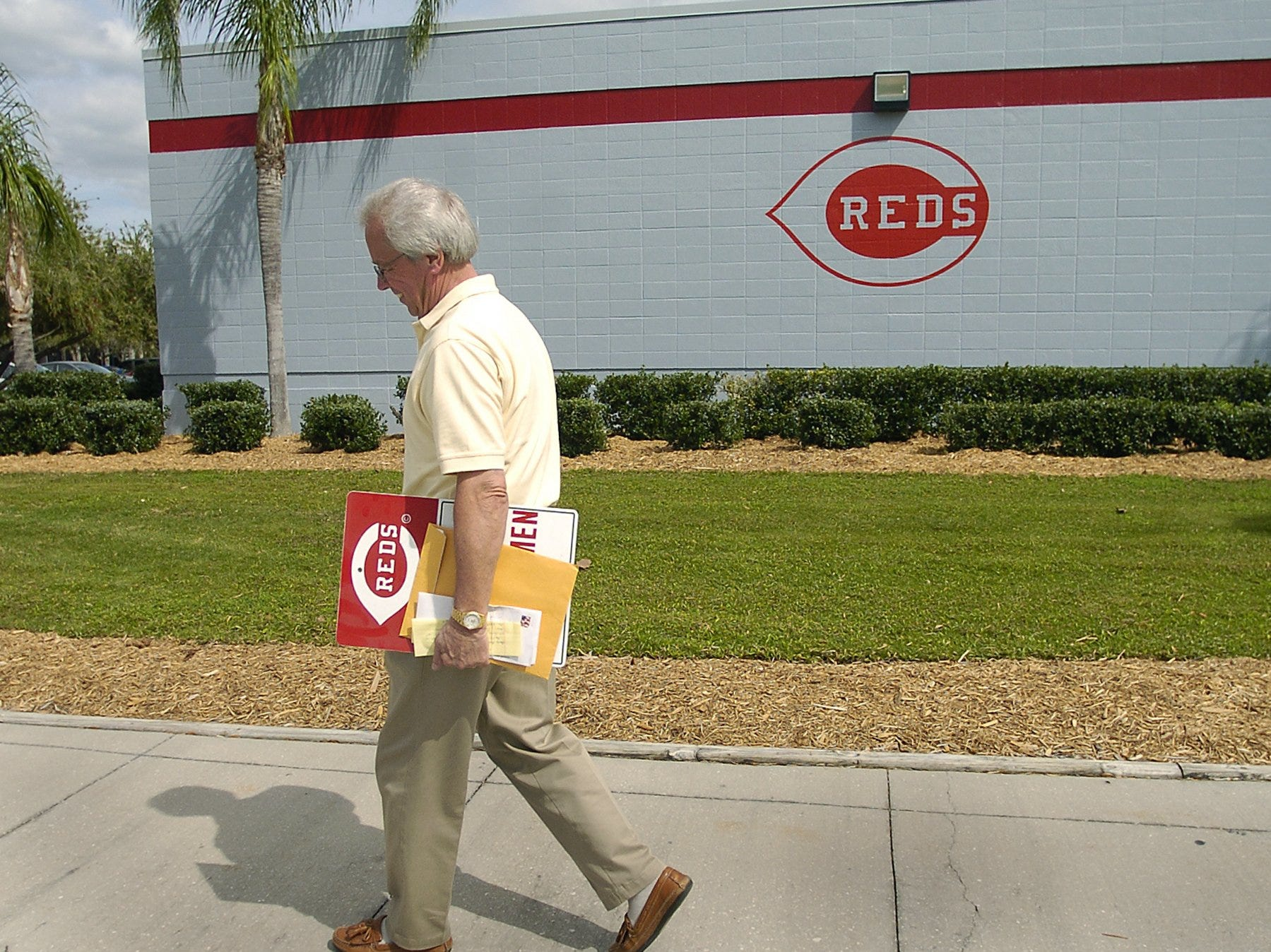 """TUESDAY MARCH 2, 2004 DAILY DAILY REDS Reds broadcaster Marty Brennaman walks to his car at the Cincinnati Reds Spring Training Complex in Sarasota, Florida. Brennaman commented on the death of former Reds owner Marge Schott. """"I told her affectionately...she was a tough old broad,' said Brennaman."""