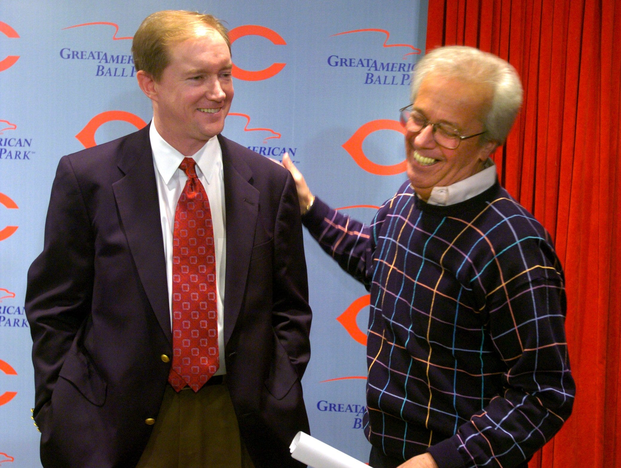 Steve Stewart, left, gets a congratulatory pat from Marty Brennaman during a press conference Wednesday afternoon February 11, 2004 at Great American Ball Park where in was announced that he will succeed Joe Nuxhall in the Cincinnati Reds radio broadcast booth. Cincinnati Enquirer photo by Gary Landers
