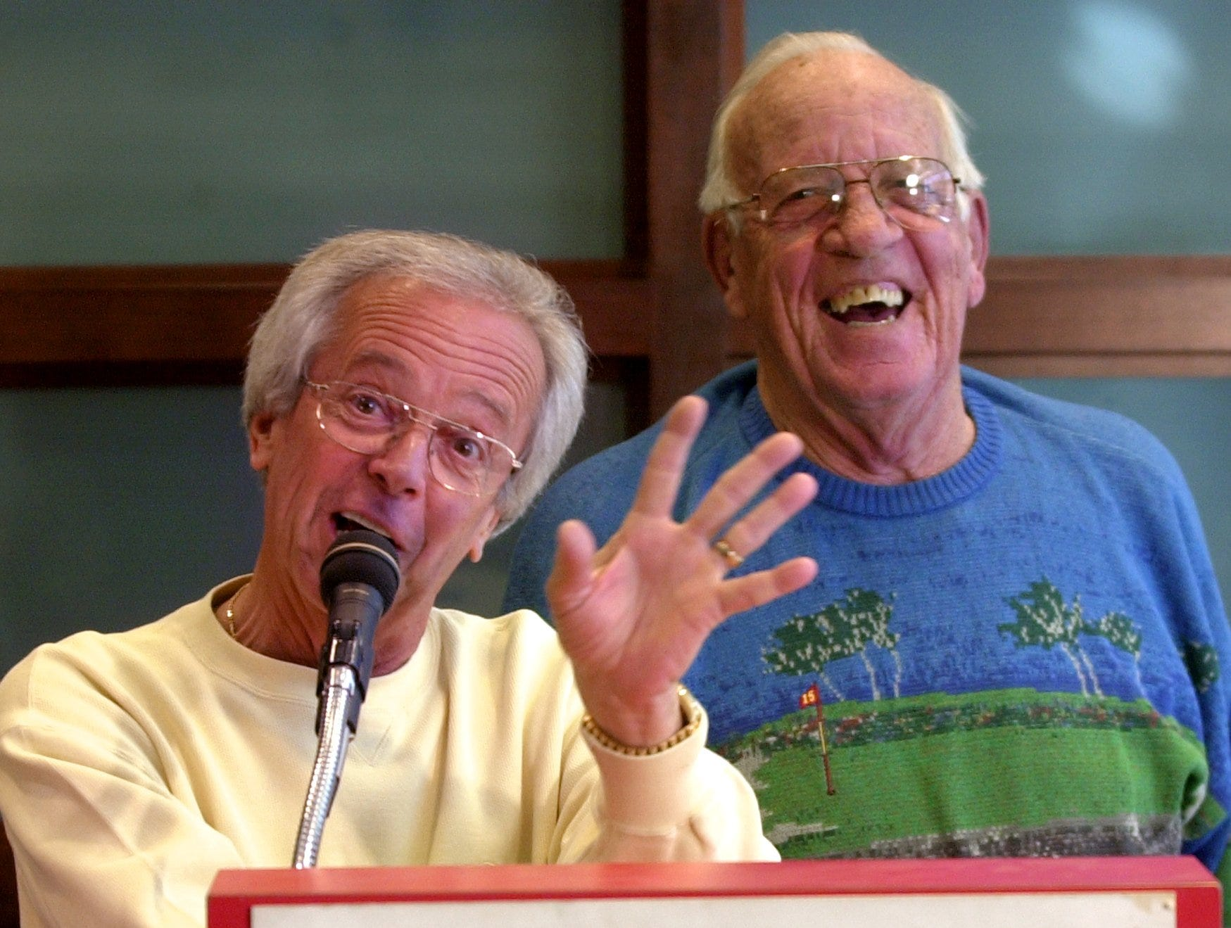 """2002.11.01.08.01 NUXHALL SPORTS : Cincinnati Reds radio broadcasters Marty Brennaman (left) and Joe Nuxhall (right) tell stories about baseball and some """"inside jokes"""" as Marty called them during a press conference announcing Nuxhall's retirement in 2004. This will give him a full season this season and 60 games the next season. One game for each year he has been with the organization. The press conference was held at the new administration building at the Great American Ball Park Friday November 1, 2002."""