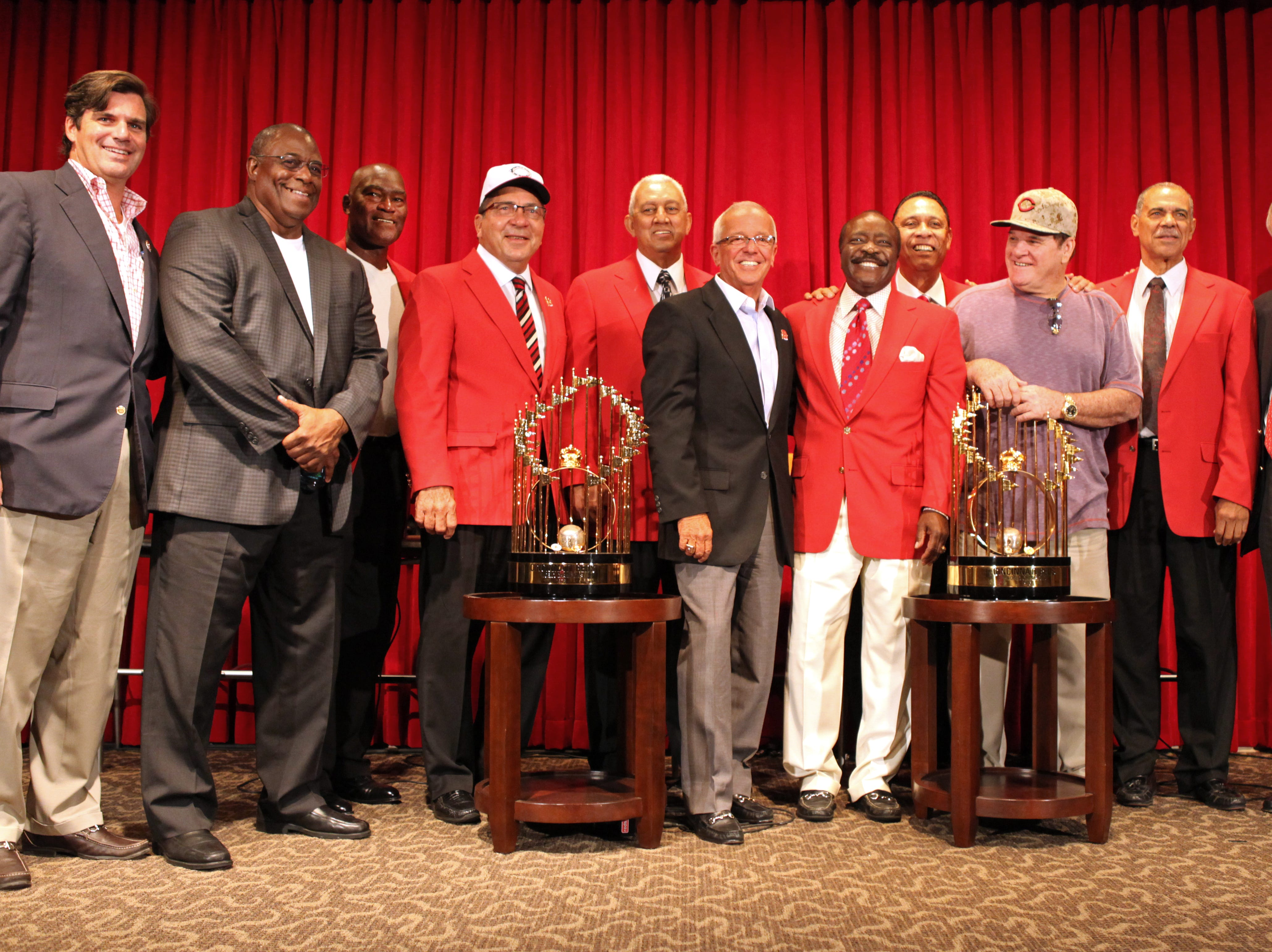 Saturday, Sept. 7, 2013 The ÒGreat EightÓ from the 1975 & 1976 World Championship era, held a press conference following the dedication of Joe Morgan's sculpture that is at the entrance of Great American Ballpark. After, they posed with a photo, along with Phil Castellini, left, Marty Brennaman, center and Reds owner Bob Castellini, right. The 'Great Eight' L-R) Ken Griffey Sr. (right field), George Foster (left field), Johnny Bench (catcher), David Concepcion (shortstop), Joe Morgan (second base), Tony Perez (first base), Pete Rose (third base) and Cesar Geronimo (center field). This weekend was the first time the ÒGreat EightÓ assembled for an event at Great American Ball Park. The Reds were playing the Los Angeles Dodgers.
