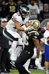 Philadelphia Eagles wide receiver Golden Tate (19) battles New Orleans Saints cornerback P.J. Williams (26) for a pass during the fourth quarter of a NFC Divisional playoff football game at Mercedes-Benz Superdome.