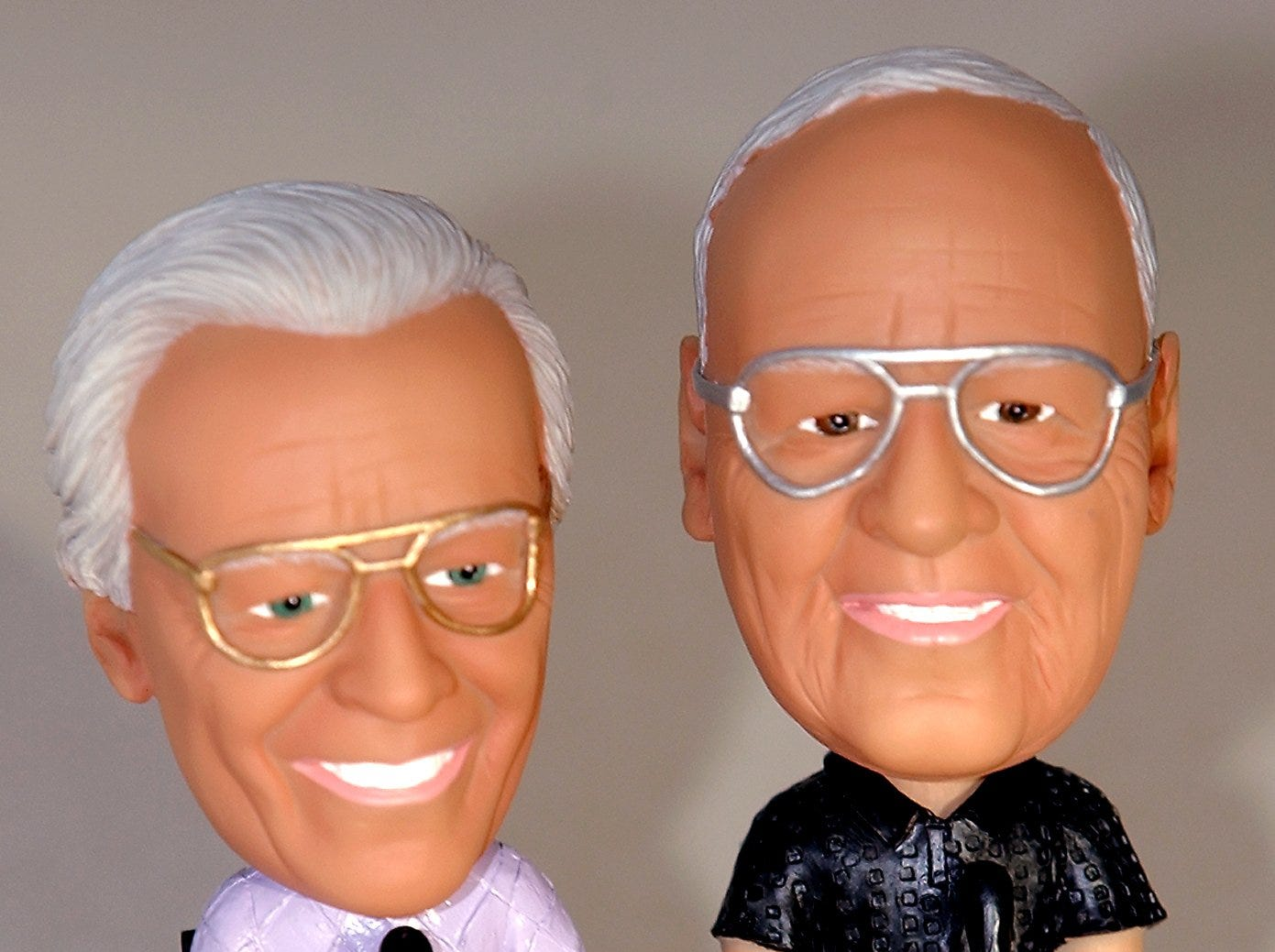 2002.0108.10.2--MARTY ANND JOE BOBBLE--Famed Reds broadcaster Joe Nuxhall and partner Marty Brennaman are seen in a new bobble head at the Reds offcies Wednesday, January 8, 2002. Photo by Craig Ruttle/Cincinnati Enquirer
