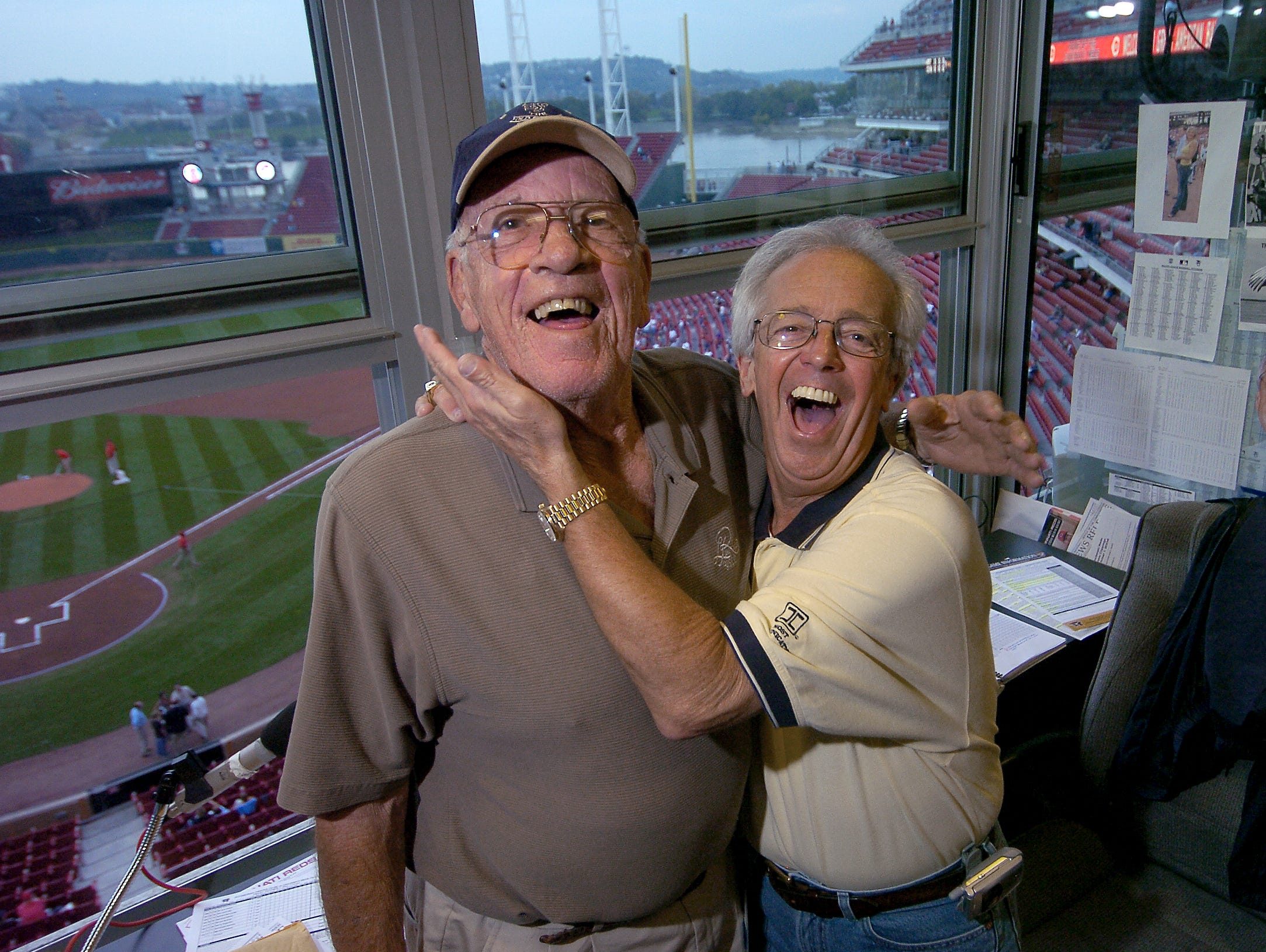 FRIDAY OCTOBER 1, 2004  NUXHALL   SPORTS Joe Nuxhall (left) and Marty Brennaman in the WLW radio booth at the Great American Ball Park prior to the start of the Reds/Pirates game.  Nuxhall is playing out his last homestand as a fulltime Reds announcer and decades-old partner to Mary Brennaman.