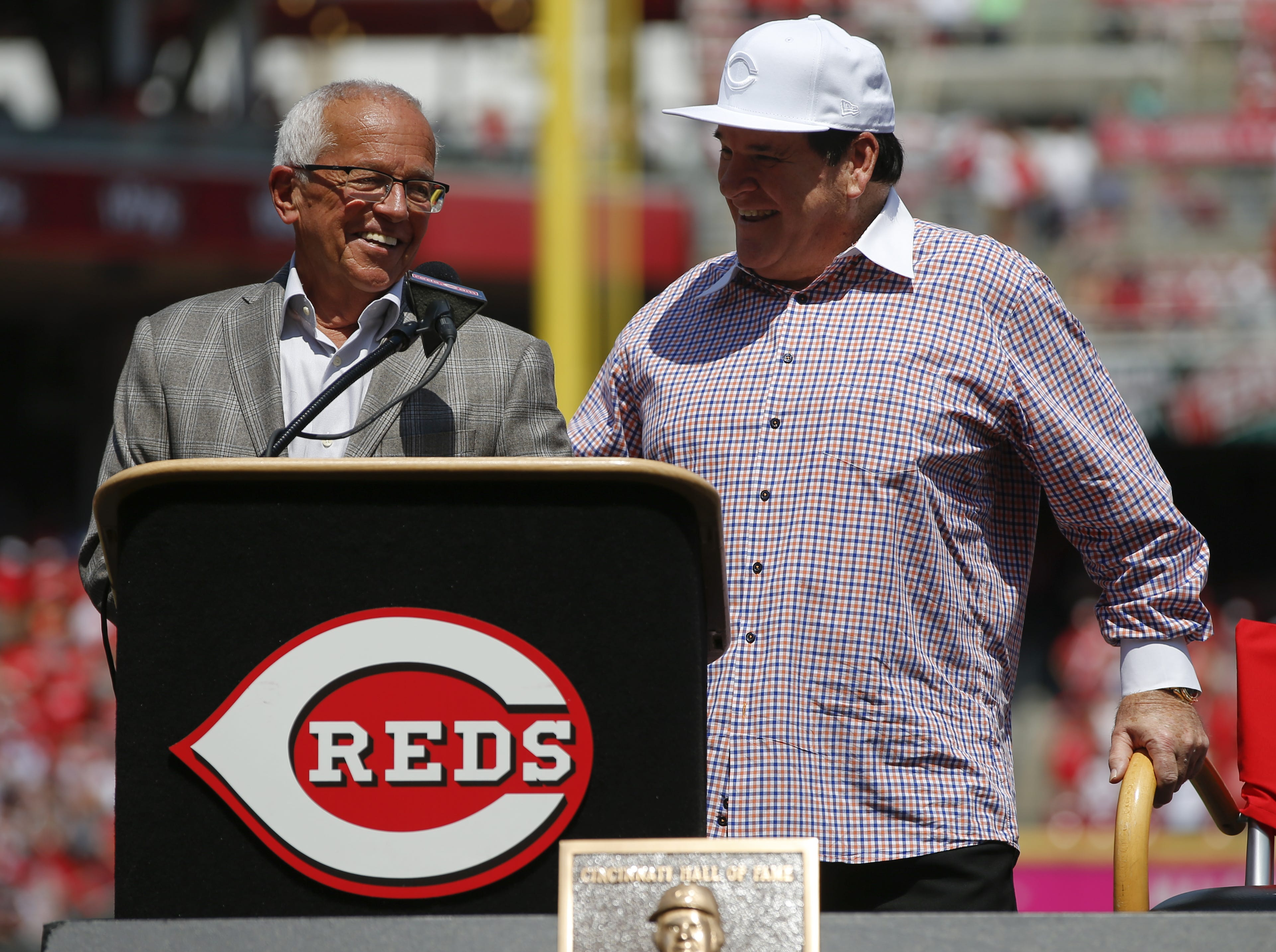 Cincinnati Reds broadcaster Marty Brennaman and 2016 Reds Hall of Fame inductee Pete Rose share a laugh during pregame ceremonies before the MLB game between the San Diego Padres and Cincinnati Reds, Saturday, June 25, 2016, at Great American Ball Park in Cincinnati.