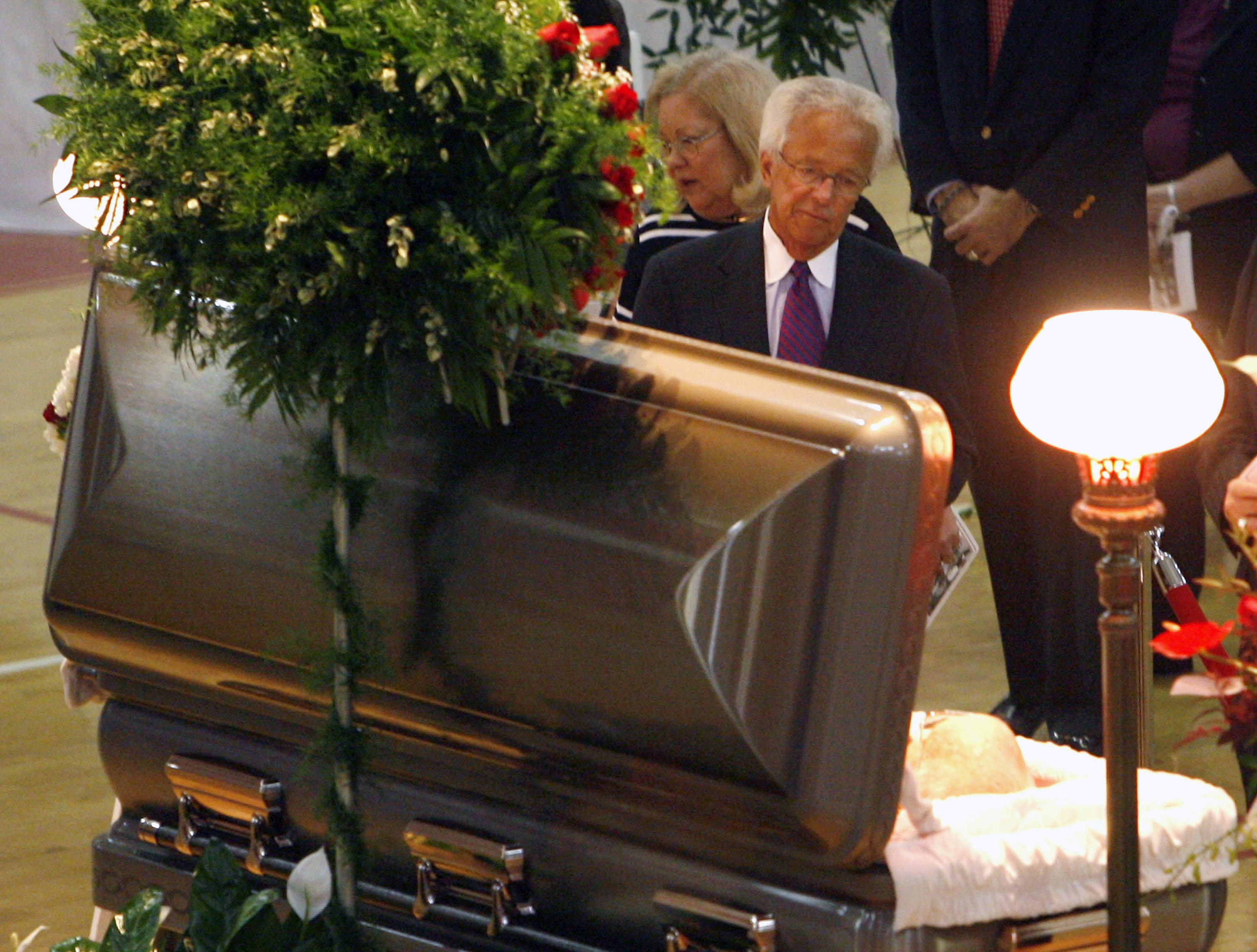 Cincinnati Reds broadcaster Marty Brennaman and his wife, Sheri, take a moment at the casket of his longtime baseball broadcast partner Joe Nuxhall during a visitation at Fairfield High School on Tuesday, Nov. 20, 2007, in Fairfield, Ohio.