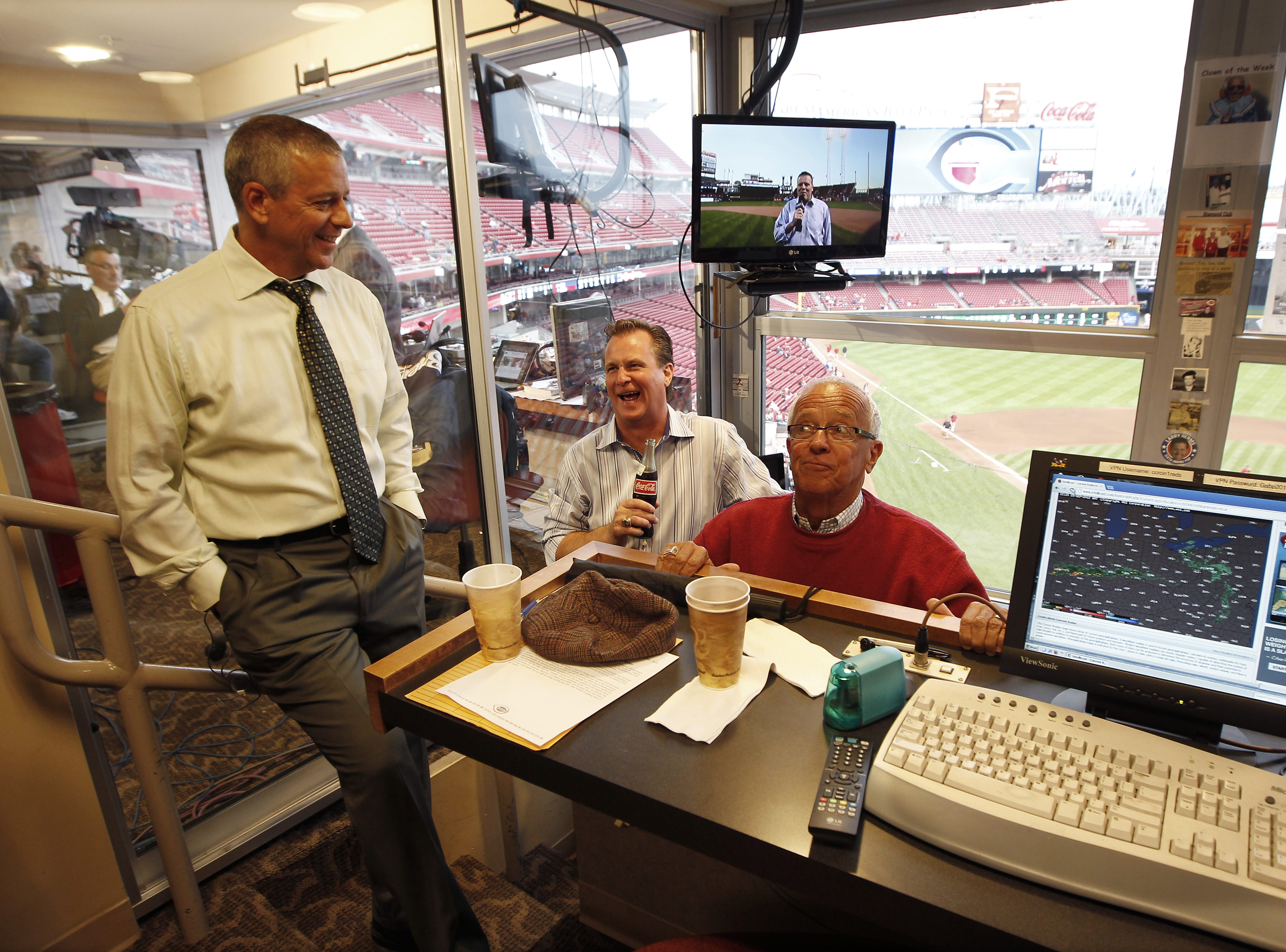 Tuesday, Sept. 25, 2012 REDS SPORTS  : The Cincinnati Reds radio broadcasteing team Thom Brennaman, left Jeff Brantley and Marty Brennaman joke around while in the radio booth prior to the Reds game against the Milwaukee Brewers at Great American Ball Park.