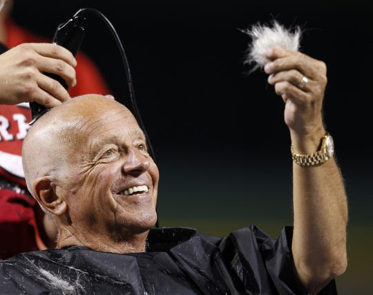 Friday, Aug. 3, 2012  REDS SPORTS : Cincinnati Reds Hall of Fame broadcaster Marty Brennaman checks out his hair as he has his head shaved due to losing a bet that the Reds could win 10 games in a row after their baseball game against the Pittsburgh Pirates at Great American Ball Park. The Enquirer/Jeff Swinger