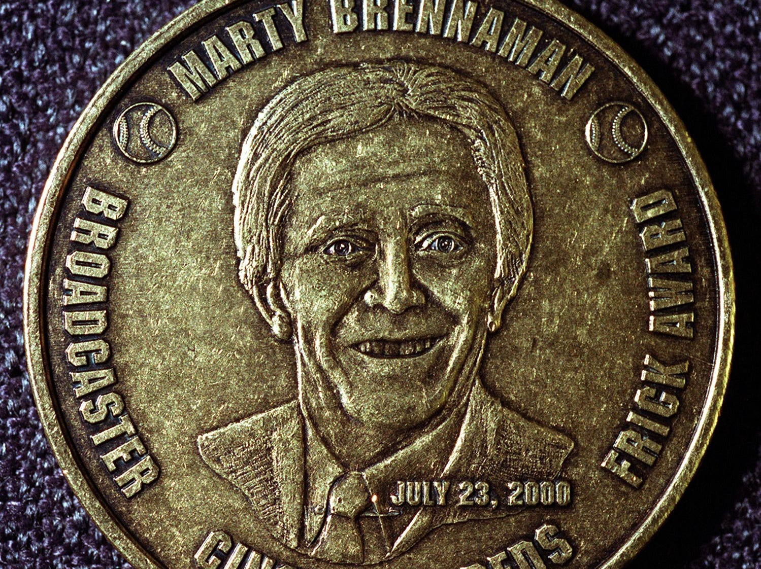 Text: 2000.0720.11.2 COINS-METRO: Osborne Coinage in Camp Washington is producing 250,000 coins of Marty Brennaman, Sparky Anderson and Tony Perez which will be sold for $1.99 each at area Kroger stores. Marty comes out Sunday. Tony and Sparky will be available in two weeks. This is a complete Marty coin (neither Tony nor Sparky were complete for photos). Photo by Glenn Hartong/The Cincinnati Enquirer. gh.