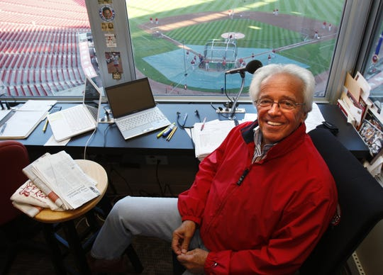 Cincinnati Reds radio broadcaster Marty Brennaman prepares for a game in his broadcast booth before the start of their game against the Houston Astros at Great American Ball Park on Sept. 29, 2010.