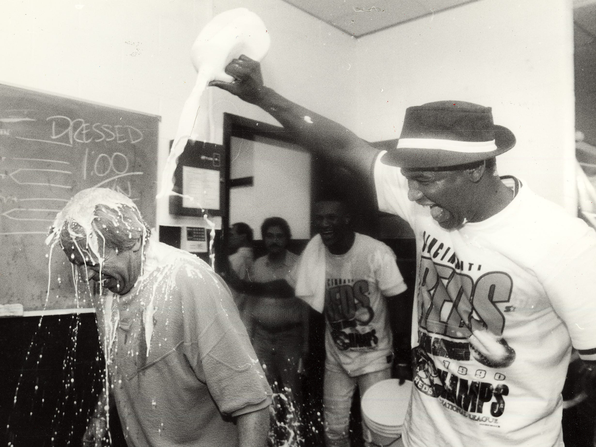 Jose Rijo drenches Reds announcer Marty Brennaman a milk after Cincinnati won the National League pennant in 1990.