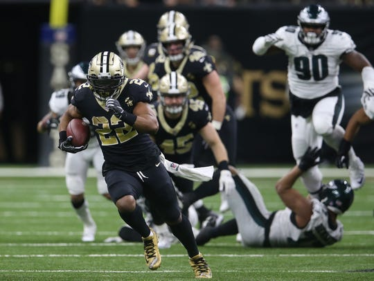 New Orleans Saints running back Mark Ingram (22) runs against the Philadelphia Eagles during the fourth quarter of a NFC Divisional playoff football game at Mercedes-Benz Superdome.