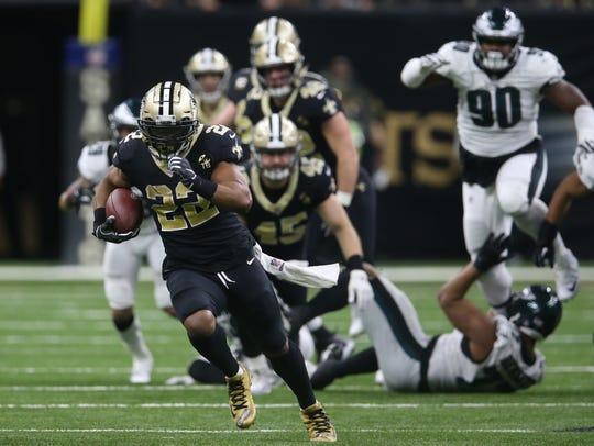 16d825773 New Orleans Saints running back Mark Ingram (22) runs against the  Philadelphia Eagles during