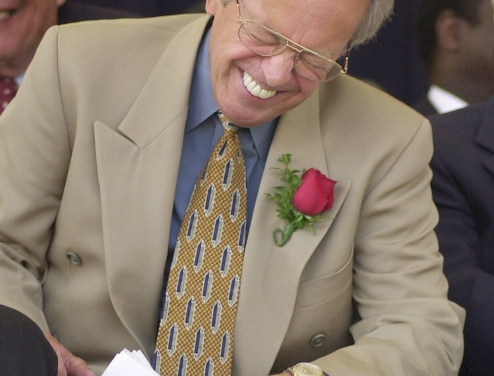 Text: 2000.0723.10.1--HALL OF FAME--nikon digital image--Marty Brennaman laughs during remarks after he recieved the Ford C. Frick award at the Baseball Hall of Fame iduction ceremony in Cooperstown, NY Sunday. Photo by Craig Ruttle/Cincinnati Enquirer