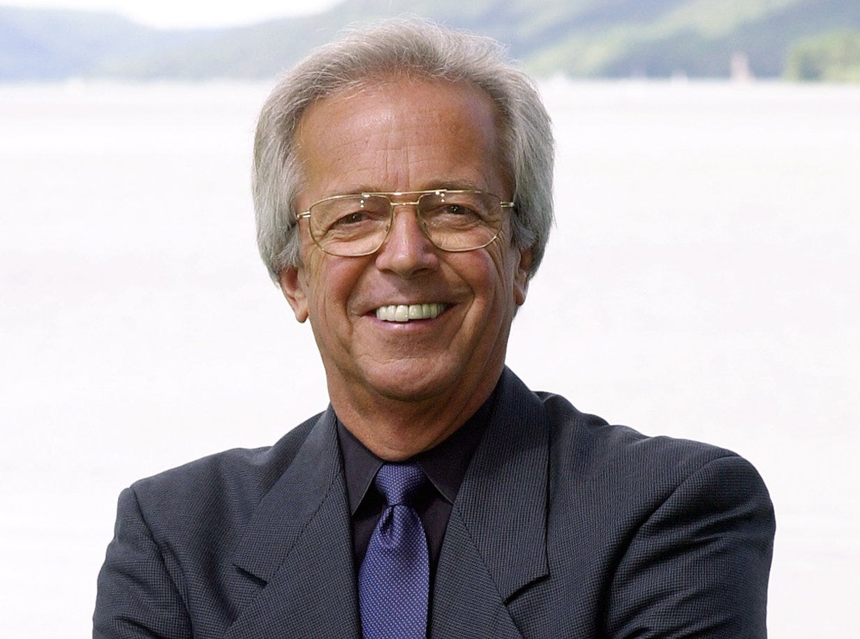 Text: 2000.0722.10.1--HALL OF FAME--nikon digital image--Reds broadcaster Marty Brennaman poses near Otsego Lake in Cooperstown, NY Saturday, a day before he will be awarded the the Ford C. Frick award at the induction ceremonies at the Baseball Hall of Fame Sunday.