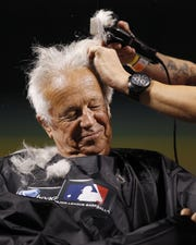 Friday, Aug. 3, 2012  REDS SPORTS : Cincinnati Reds Hall of Fame broadcaster Marty Brennaman has his head shaved due to losing a bet that the Reds could win 10 games in a row after their baseball game against the Pittsburgh Pirates at Great American Ball Park. The Enquirer/Jeff Swinger