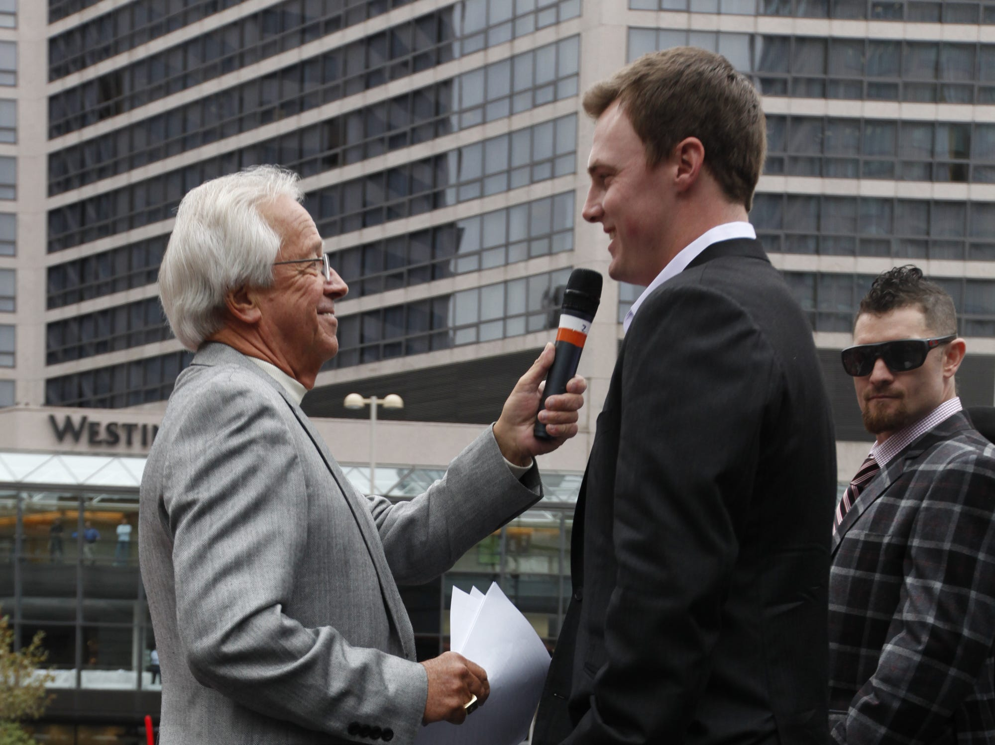 MONDAY OCTOBER 4, 2010  REDS  LOCAL Reds radio broadcaster and Hall of Famer Marty Brennaman, left,  talks with National League Player of the Week Jay Bruce. The National League Central Division Champion Cincinnati Reds held a pep rally of sorts on FOuntain Square before departing for Philadelphia, Pa..  The Reds will meet the Phillies in a best of five game series starting Wednesday afternoon.  The Enquirer/Michael E. Keating