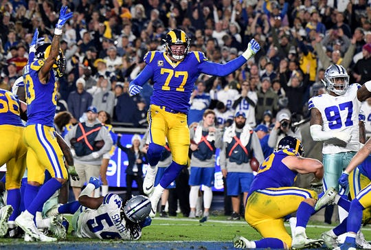 Offensive tackle Andrew Whitworth #77 of the Los Angeles Rams reacts after C.J. Anderson runs for a touchdown against the Dallas Cowboys in the second half of a NFL playoff football game at the Los Angeles Memorial Coliseum on Saturday, January 12, 2018 in Los Angeles, California. Los Angeles Rams won 30-22.