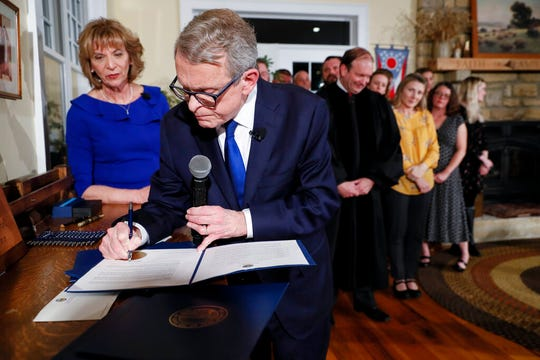 The announcement by Ohio Gov. Mike DeWine Friday followed a federal judge's ruling earlier this month that said Ohio's current execution protocol would cause the inmate needless suffering.
