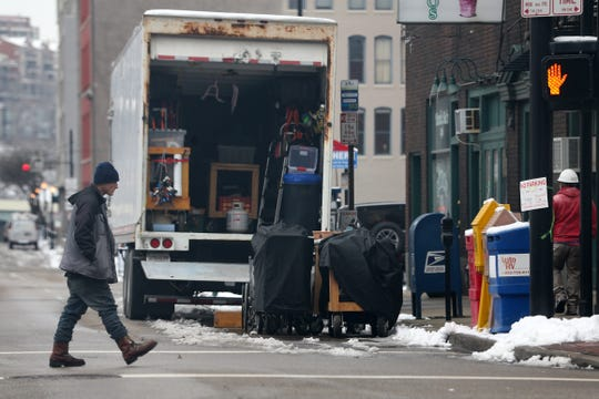 "Film crews unload equipment at the intersection of Main and Seventh streets, Monday, Jan. 14, 2019, in downtown Cincinnati for the production of the film ""Dry Run."" Most of the filming for the movie, which features Mark Ruffalo, Anne Hathaway and Tim Robbins, will be shot indoors in several office buildings downtown."