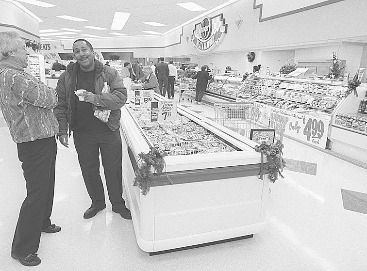 Text: kroger /biz/ 11-14-96; wlw radio broadcaster marty brennaman shares a laugh with bob williams of winton place thursday morning at the grand opening of a new kroger store on mitchell avenue between spring grove ave. and i-75. cincinnati enquirer photo by gary landers. gl