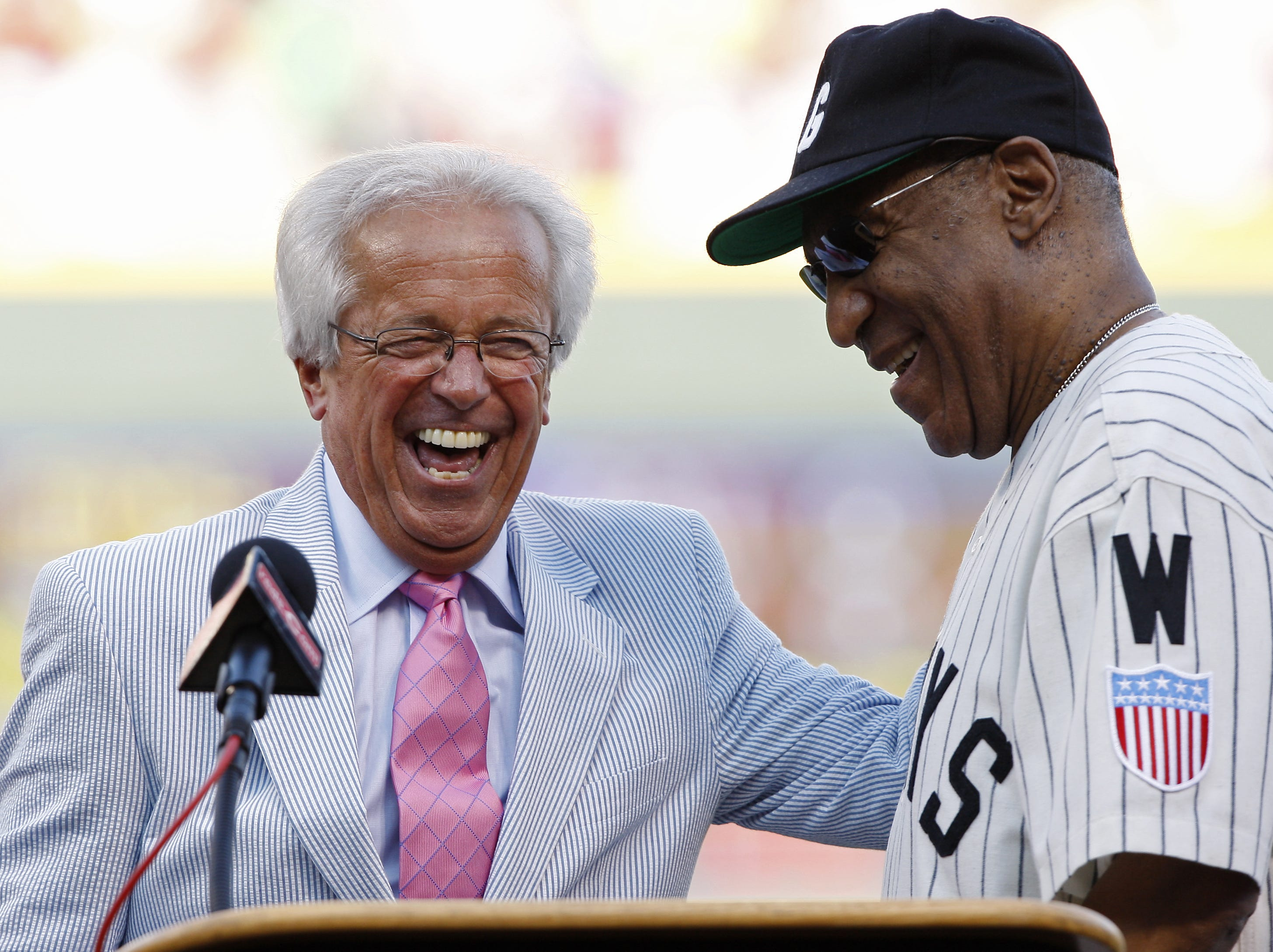 2009.06.20 REDS SPORTS :  The Cincinnati Reds announcer Marty Brennaman and MLB Beacon of Hope Award recipient Bill Cosby joke around during the pre-game ceremonies before the Cincinnati Reds Chicago White Sox Major League Baseball Gillette Civil Rights Game at Great American Ball Park Saturday June 20, 2009. The Enquirer/Jeff Swinger