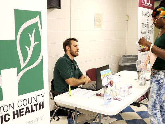 Hamilton County Narcan Distribution worker shows a visitor at the county jail how the opioid-overdose reversal medicine Narcan works.